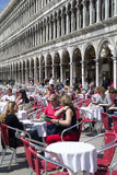 Outdoor cafe scene in San Marco square in Venice Royalty Free Stock Photo