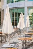 Outdoor cafe seating with round tables and white Royalty Free Stock Photography