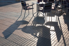 Outdoor Cafe with Shadows Stock Photography