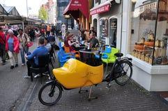 Outdoor cafe at Singel flower market, Amsterdam, Netherlands Stock Photo