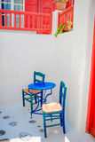Outdoor cafe on street of typical greek traditional village on Mykonos Island, Europe Royalty Free Stock Images