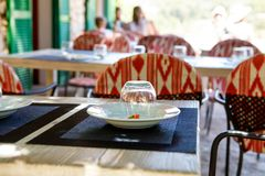 Outdoor cafe, table set for a luncho on sunny warm day. Mediterran city or town.  Stock Photography