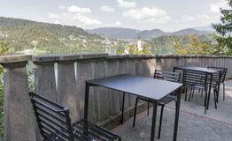 Outdoor cafe tables with above view over lake Bled Royalty Free Stock Image
