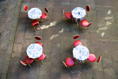 Outdoor cafe tables and chairs Royalty Free Stock Image