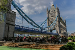 Outdoor cafe by Tower Bridge. Patrons of an outdoor cafe next to London's historic Tower Bridge Royalty Free Stock Image