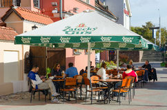 Outdoor cafe in Trinity Suburb on sunny autumn day, Minsk. MINSK, BELARUS - OCTOBER 1, 2016: Unidentified people are relaxing at outdoor cafe in Trinity Suburb Royalty Free Stock Photos