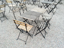 Outdoor cafe with wooden tables Royalty Free Stock Photos