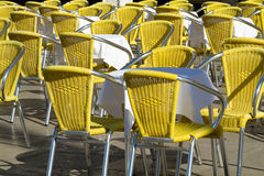 Outdoor cafe with yellow chairs. Stock Photography