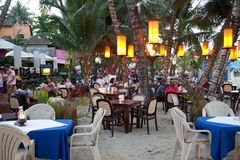 People dining out on the beach. Outdoor cafes on beach in Cabarete Royalty Free Stock Photography