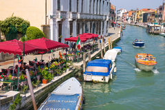 Outdoor cafes on the canal in  Venice, Italy Royalty Free Stock Image