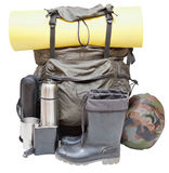 Outdoor camping equipment isolated on white. Set of camping equipment with backpack, rolled sleeping pad, boots, thermos, knife, flask, can, sleeping bag royalty free stock image