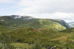 Outdoor Camping In Norway. Red tents in the mountains along the Sognefjellet touristic route from Lom to Gaupne - Norway royalty free stock photo