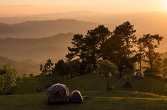 Outdoor camping park on mountain at sunset moment Royalty Free Stock Images