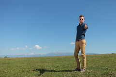 Outdoor casual man shows thums up Stock Photography