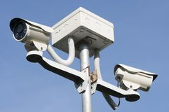 Outdoor CCTV Camera Operating for security in garden. On blue sky background royalty free stock image