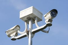 Outdoor CCTV Camera Operating for security in garden. On blue sky background royalty free stock images