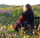 Outdoor cello practice in spring Stock Image