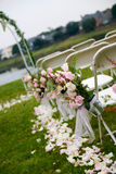 Outdoor Ceremony. A tilted shot of an outdoor wedding aisle royalty free stock photography