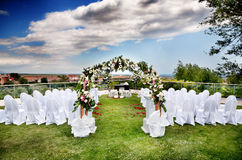 Outdoor ceremony. Beautiful ceremony venue with flowers and blue sky Royalty Free Stock Photos