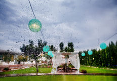 Outdoor ceremony. Decoration of celebrations. Rain through the window Royalty Free Stock Photography