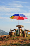Outdoor chair. Field chair wood umbrella on mountain Stock Photography
