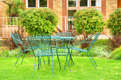 Outdoor chairs on lawn Royalty Free Stock Photos
