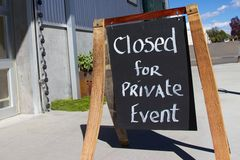 Outdoor chalkboard sign reading closed for private event Royalty Free Stock Photo