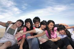 Outdoor cheerful. Asian young group cheerful at beach royalty free stock photography