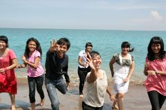 Outdoor cheerful. Asian young group cheerful at beach royalty free stock photo