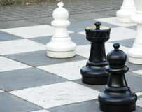 Outdoor chess. Some chess pieces of an outdoor game Royalty Free Stock Photos