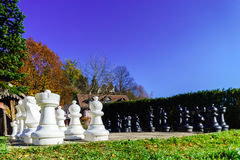 Outdoor chess board with big figures Royalty Free Stock Photos