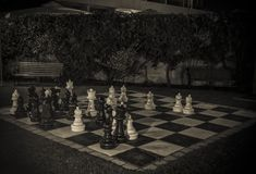 Outdoor Chess Board. A large chessboard in a garden at night Royalty Free Stock Image