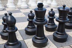 Outdoor chess board with plastic pieces Royalty Free Stock Photos