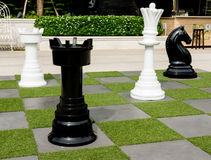 Outdoor chess on the garden. Outdoor chess board and big chess on the garden Stock Images