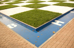 Outdoor Chess Table. A grass chess table in a park stock photo