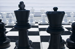 Outdoor Chessboard. King and Queen on an Outdoor Chessboard Royalty Free Stock Image