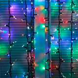 Outdoor Christmas lamp strings decorate window Stock Image
