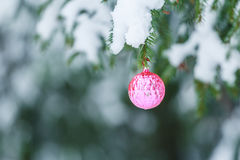 Outdoor Christmas magenta round mirror ball Stock Photo