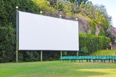 Outdoor cinema with white projection screen.  stock photography
