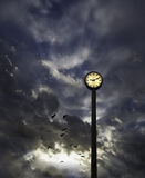 Outdoor clock and cloudy sky Royalty Free Stock Photos