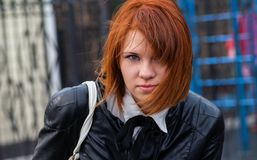 Outdoor close-up portrait of beautiful redhair young girl Stock Image
