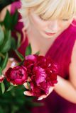 Outdoor close up portrait of beautiful young woman in the blooming garden. Female spring fashion concept royalty free stock image