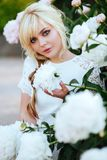 Outdoor close up portrait of beautiful young woman in the blooming garden. Female spring fashion concept royalty free stock photos