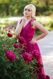 Outdoor close up portrait of beautiful young woman in the blooming garden. Female spring fashion concept stock photo