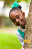 Outdoor close up portrait of a cute young black girl - African p Royalty Free Stock Image