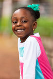 Outdoor close up portrait of a cute young black girl - African p stock image