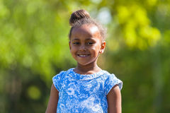 Outdoor close up portrait of a cute young black girl - African p Royalty Free Stock Photography