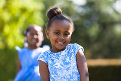 Outdoor close up portrait of a cute young black girl - African p stock photo