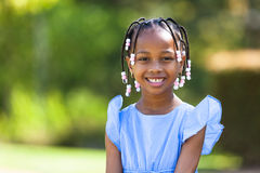 Outdoor close up portrait of a cute young black girl - African p stock images