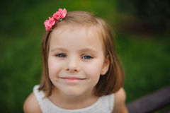 Outdoor close up portrait of a cute young girl smiling Stock Photography